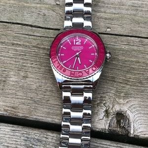 Pink and stainless steel Coach watch